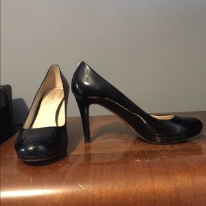 Black coach pumps